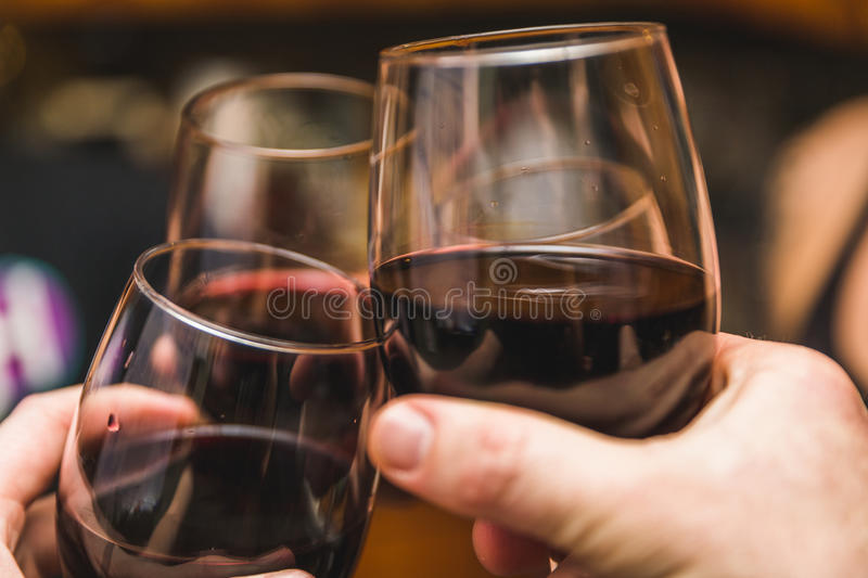 Three Wine Glasses Touching royalty free stock image