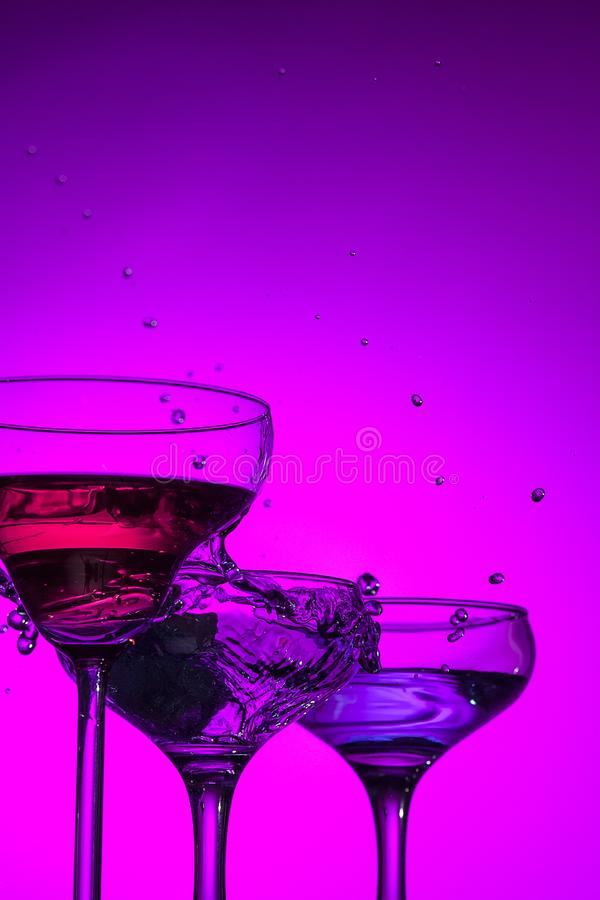 Three wine glasses standing on the table at studio stock photography