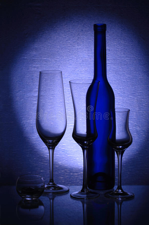 Download Three Wineglasses, A Candlestick And A Bottle Stock Photo - Image: 23812310