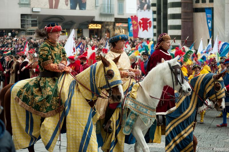 Three Wise Men on horseback in the Cathedral Square of Florence. stock photo
