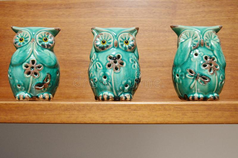 Three wise owls statuettes royalty free stock images