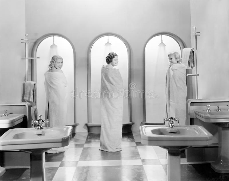 Three women in a bathroom together royalty free stock images