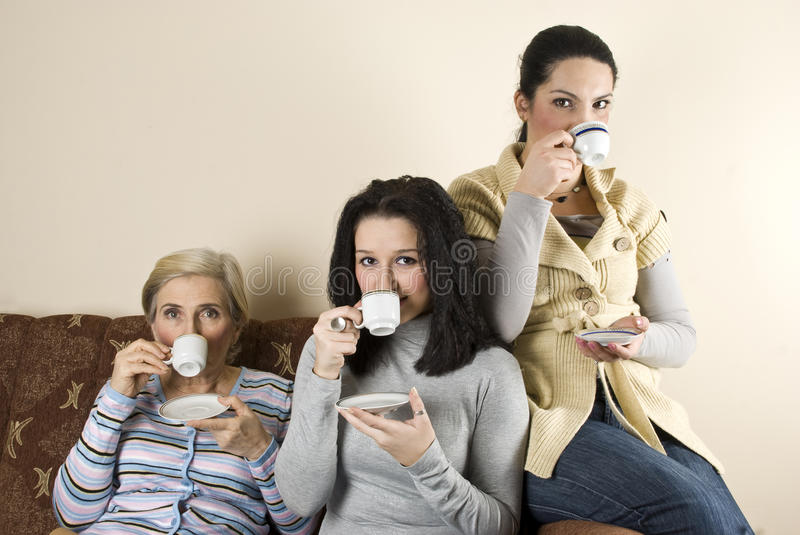Three women friends drinking coffee royalty free stock photography