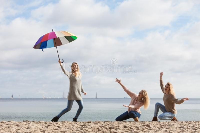 Women having fun with umbrella royalty free stock image