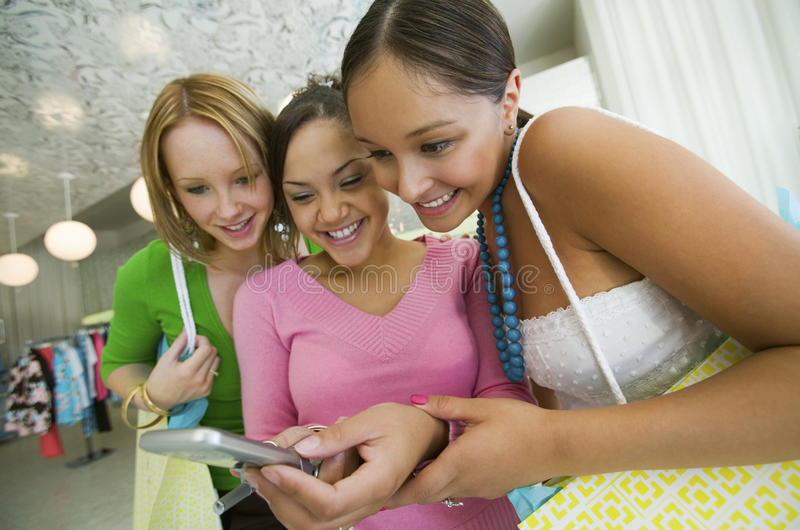 Three Women Looking at Cell Phone Picture royalty free stock photo