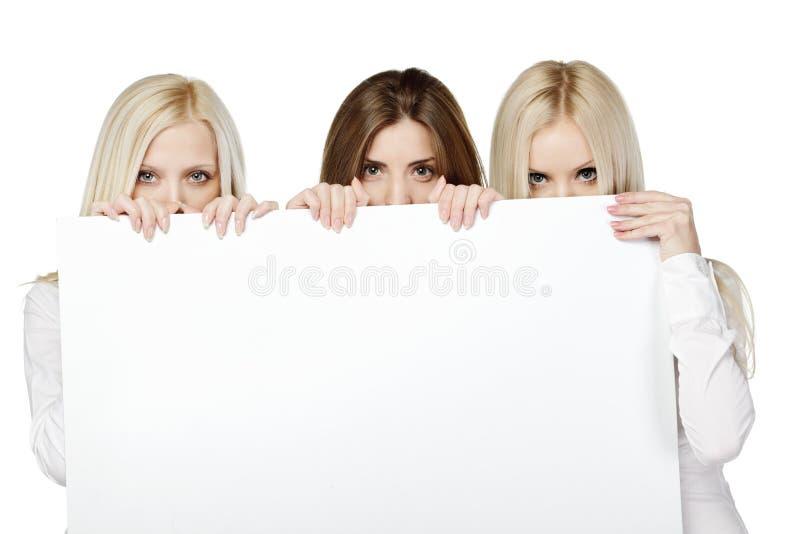 Download Three Women Peeking Over White Board Stock Photo - Image: 24442356