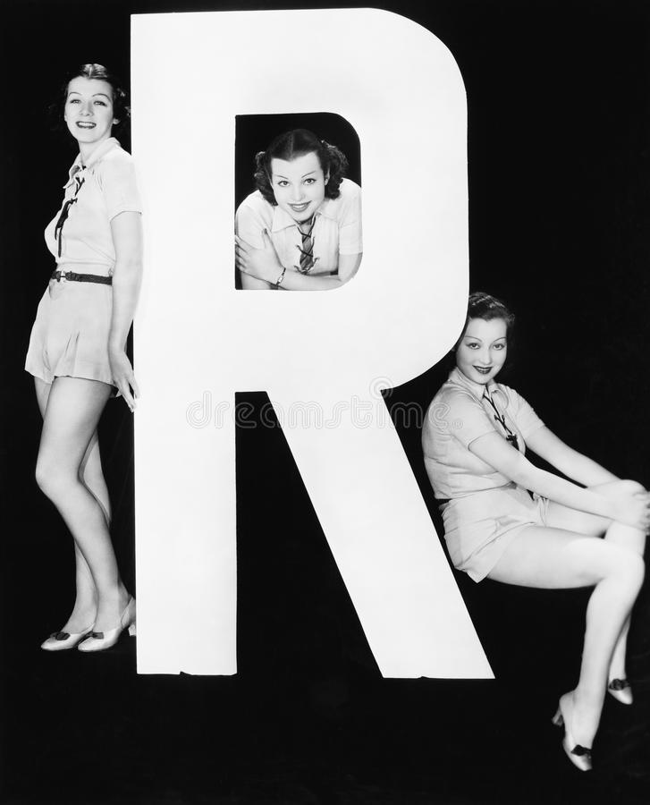 Three women posing with huge letter R. (All persons depicted are no longer living and no estate exists. Supplier grants that there will be no model release royalty free stock image