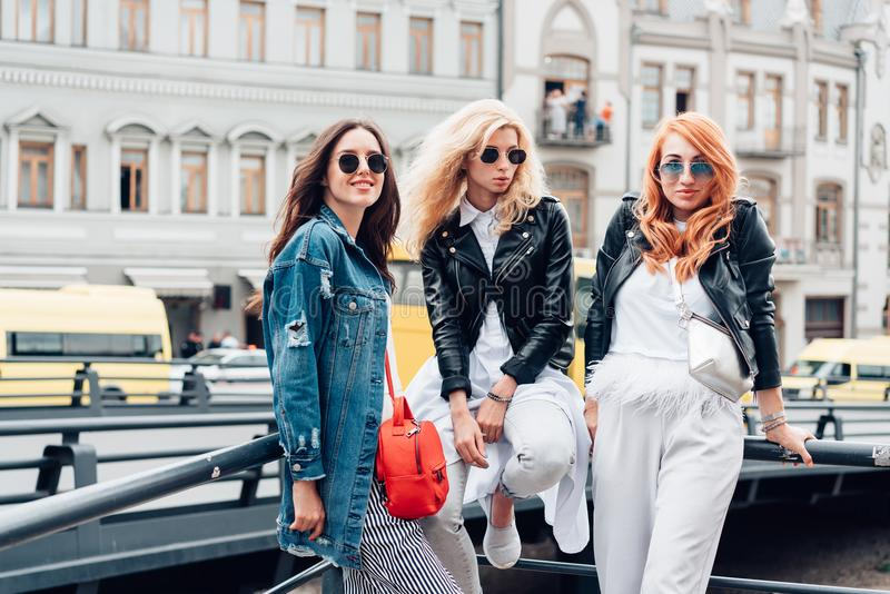 Three beautiful girls on the street royalty free stock images