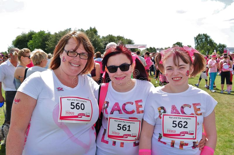 Three women at Race For Life event stock images