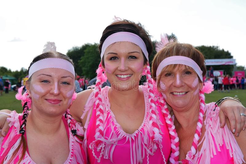 Three women at Race For Life event royalty free stock image