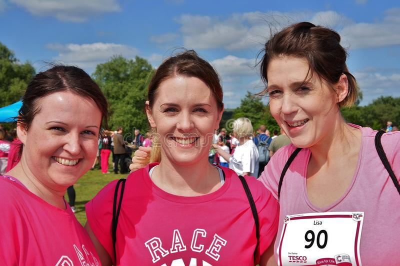Three women at Race For Life event stock image