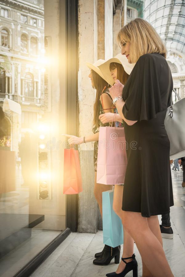 Three women shopping in Naples royalty free stock image