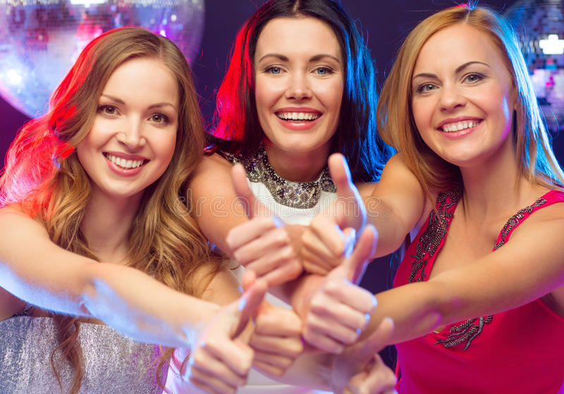 Three Women Showing Thumbs Up Stock Photos