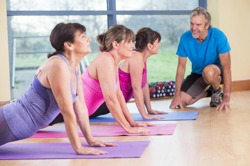 Three women stretching at the gym royalty free stock images
