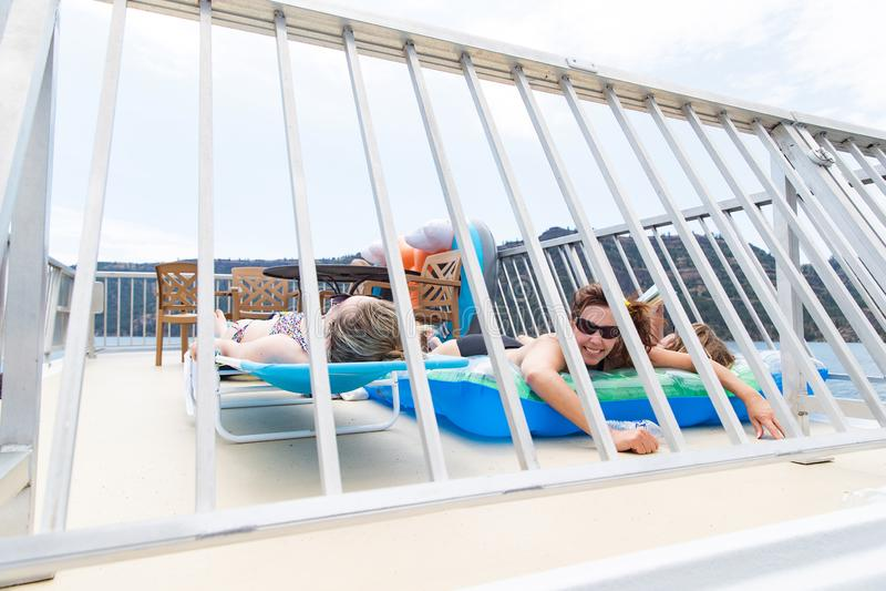 Three women tanning under the sun stock photos