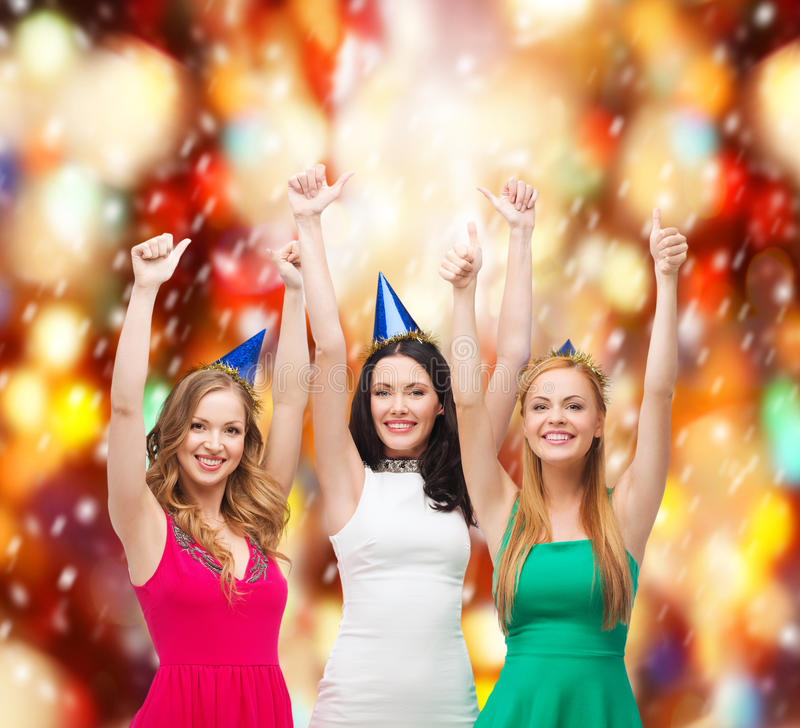 Download Three Women Wearing Hats And Showing Thumbs Up Stock Photo - Image: 37503790