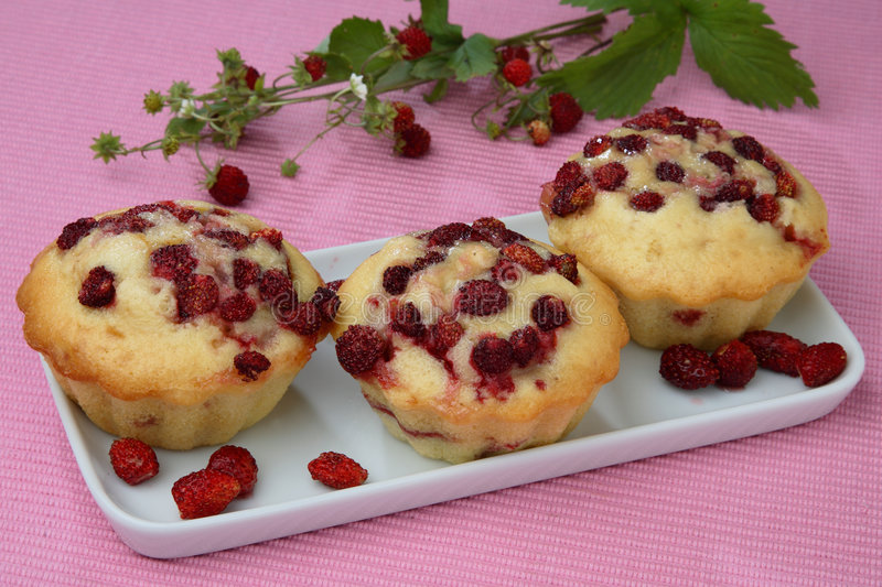 Three Wood Strawberry Muffins On Plate Royalty Free Stock Images