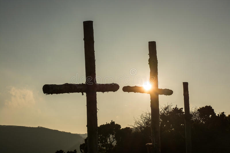 Three Wooden Crosses in sunset. Three rugged wooden crosses in the sunset at Lee Abbey in North Devon, England stock photos