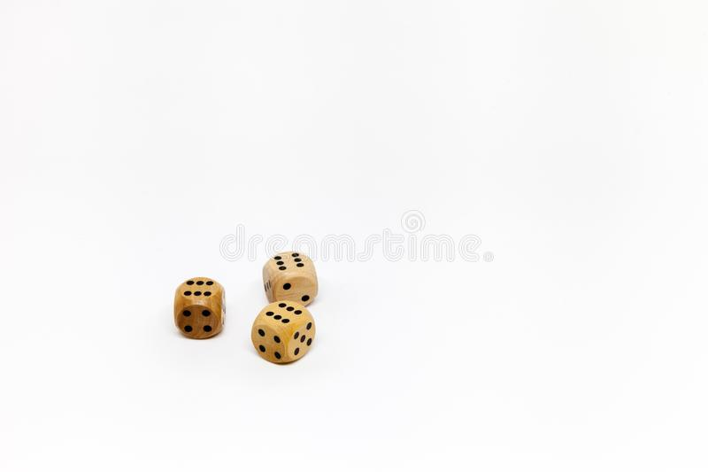 Three wooden game dice on white background. stock photo