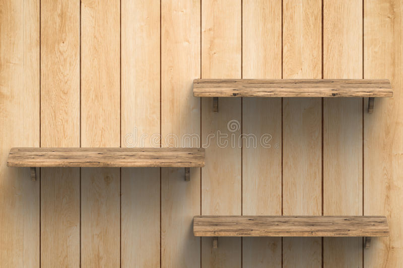 Three wooden shelves on wall stock image