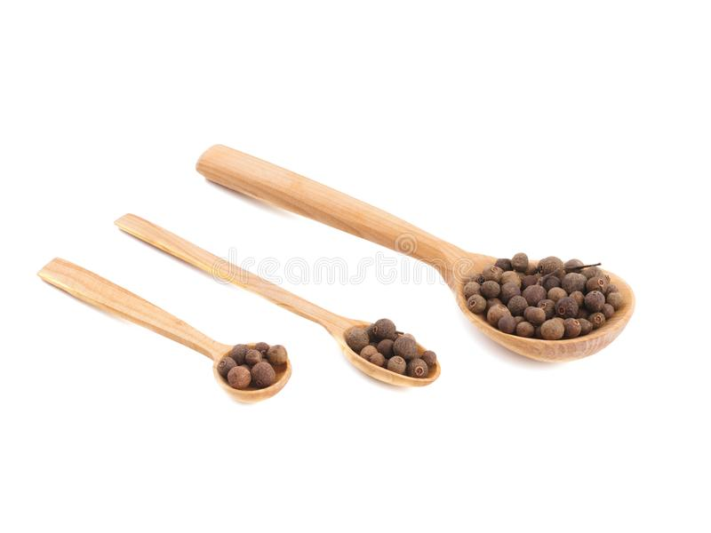 Three wooden spoons with peppercorns royalty free stock image