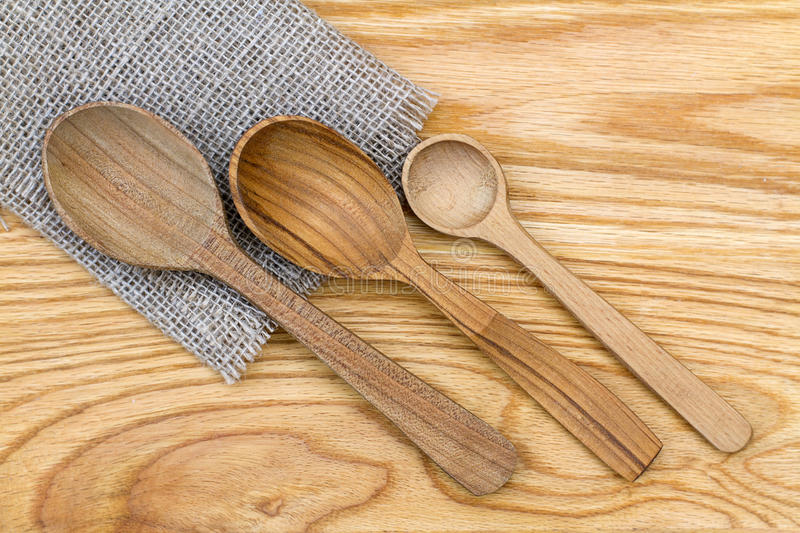 Three wooden spoons on a sacking royalty free stock photos