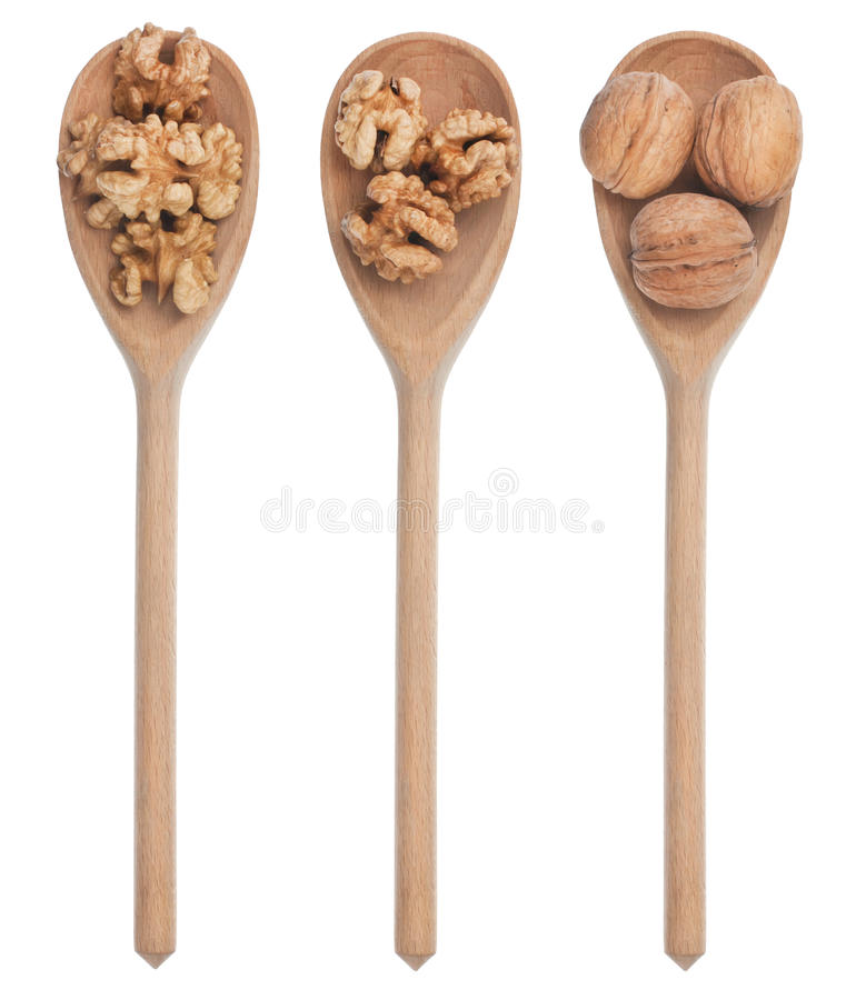 Three wooden spoons with walnut stock photography