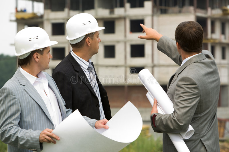 Three workers stock photo