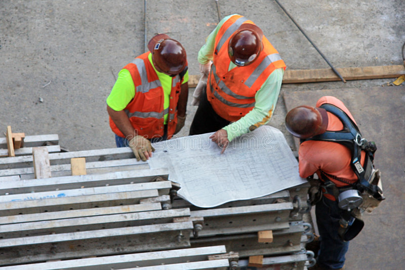 Download Three Workers With Drawing Royalty Free Stock Photos - Image: 6535568
