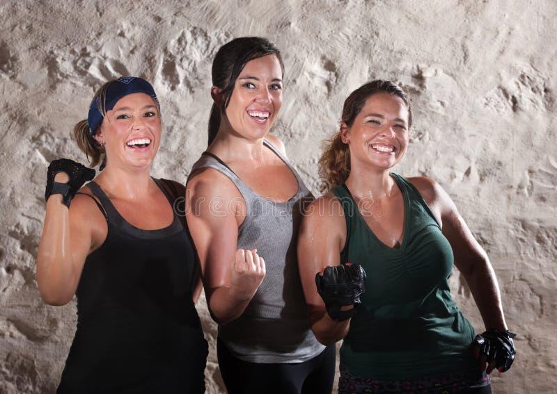 Three Workout Ladies Flex Their Biceps royalty free stock photo