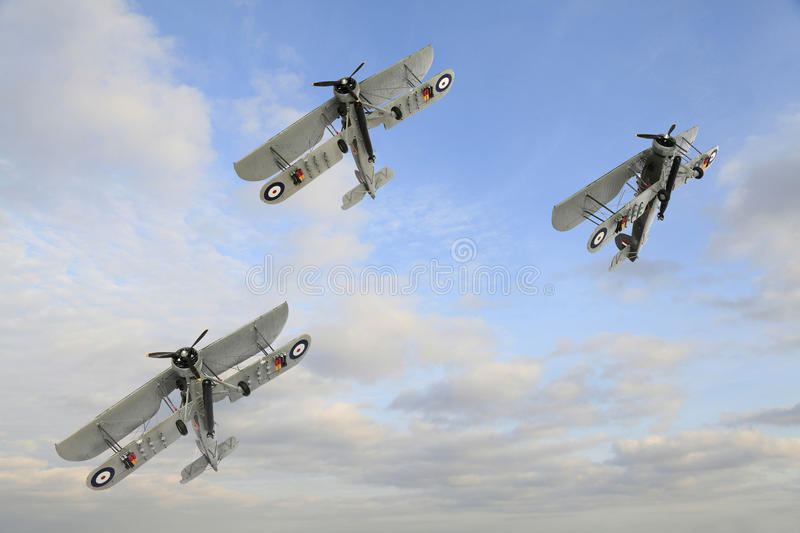 Three World War One Armstrong Whitworth FK.8 Biplanes Doing Aqrobatics stock images