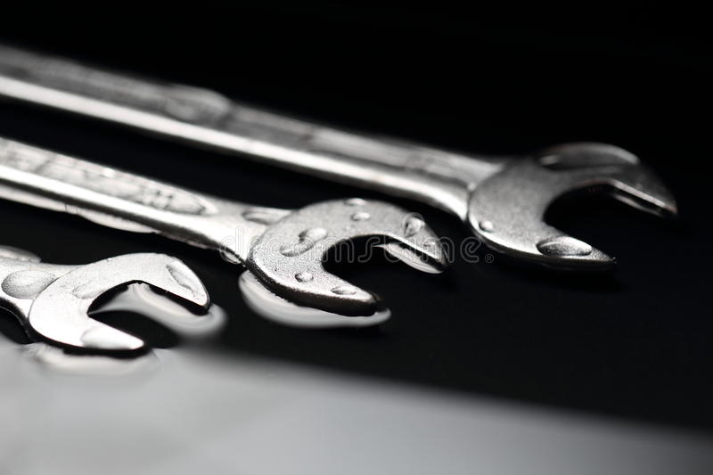 Three Wrenches as a Symbol for Teamwork in Business Groups stock photo