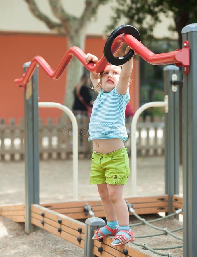 Three-year child at playground area stock images