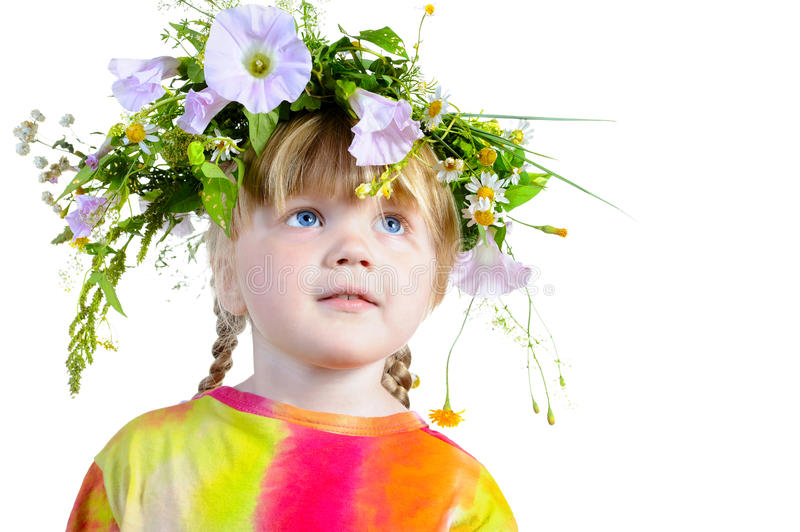 Three-year girl with a wreath on his head. stock image