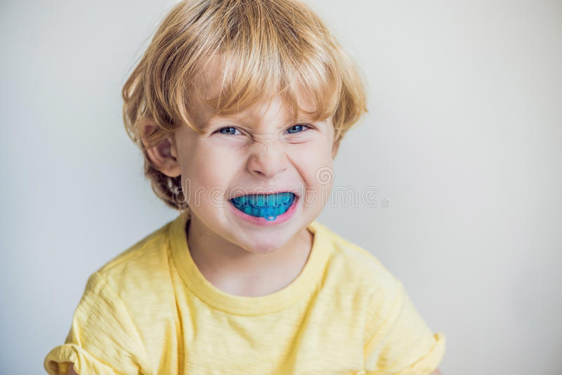 Three-year old boy shows myofunctional trainer to illuminate mouth breathing habit. Helps equalize the growing teeth and correct. Bite. Corrects the position of stock photos