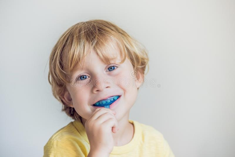 Three-year old boy shows myofunctional trainer to illuminate mouth breathing habit. Helps equalize the growing teeth and correct. Bite. Corrects the position of royalty free stock images