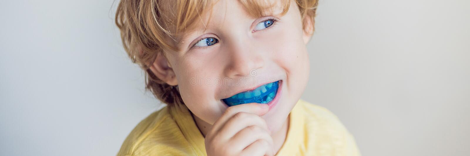 Three-year old boy shows myofunctional trainer to illuminate mouth breathing habit. Helps equalize the growing teeth and. Correct bite. Corrects the position of royalty free stock photo