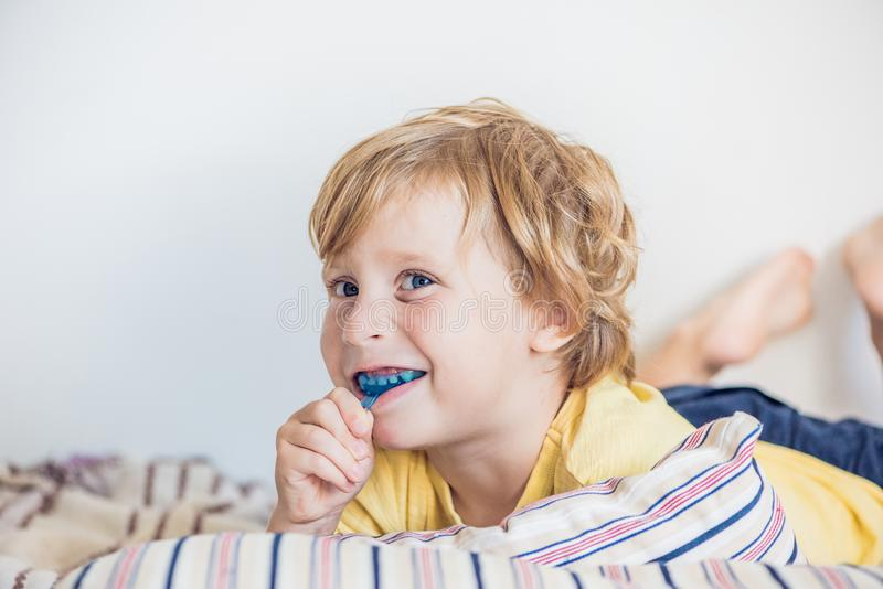 Three-year old boy shows myofunctional trainer to illuminate mouth breathing habit. Helps equalize the growing teeth and correct b. Ite. Corrects the position of stock photos