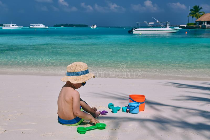 Three year old toddler playing on beach royalty free stock images