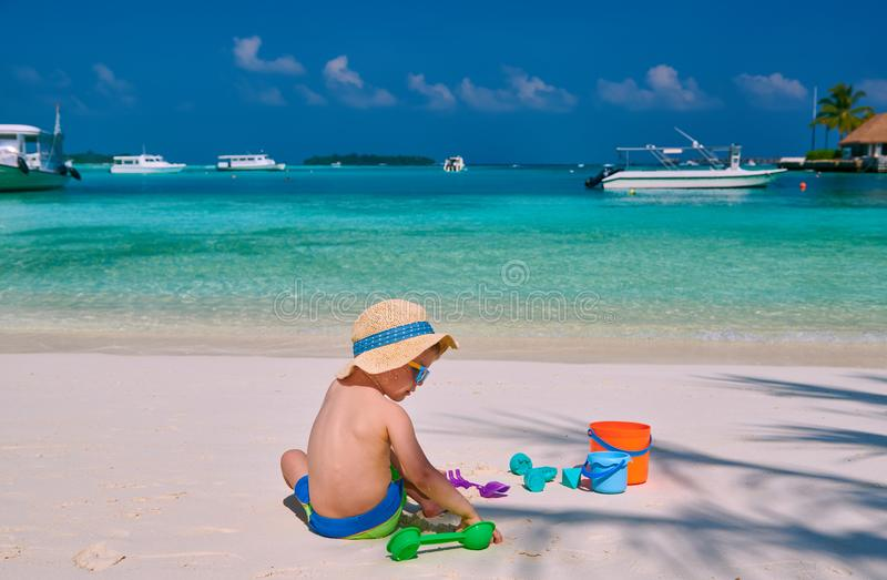 Three year old toddler playing on beach royalty free stock photography