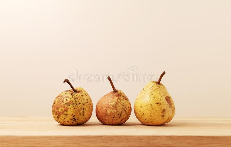 Three yellow garden ugly pears royalty free stock photos