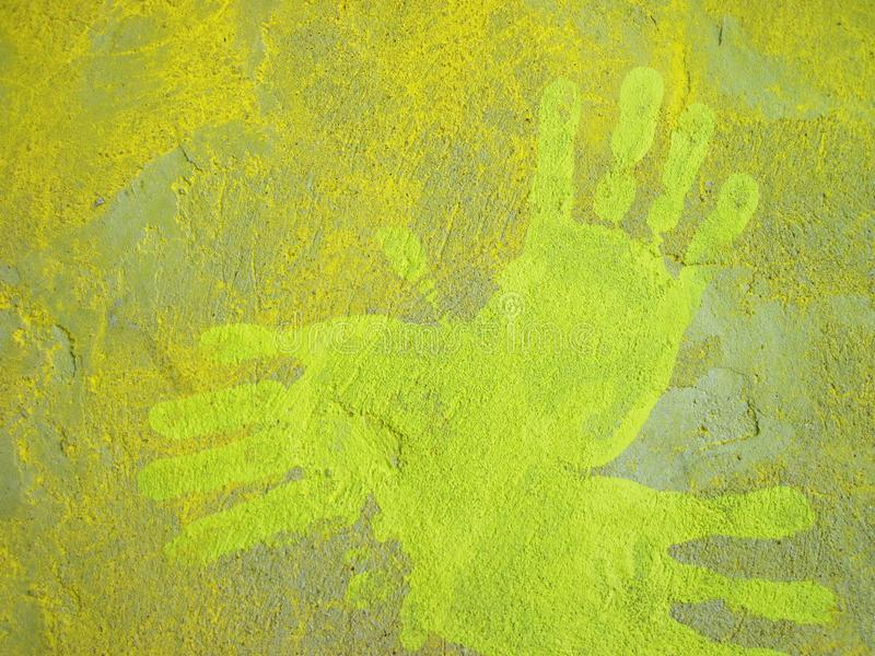 Yellow pressed palm on wall royalty free stock image