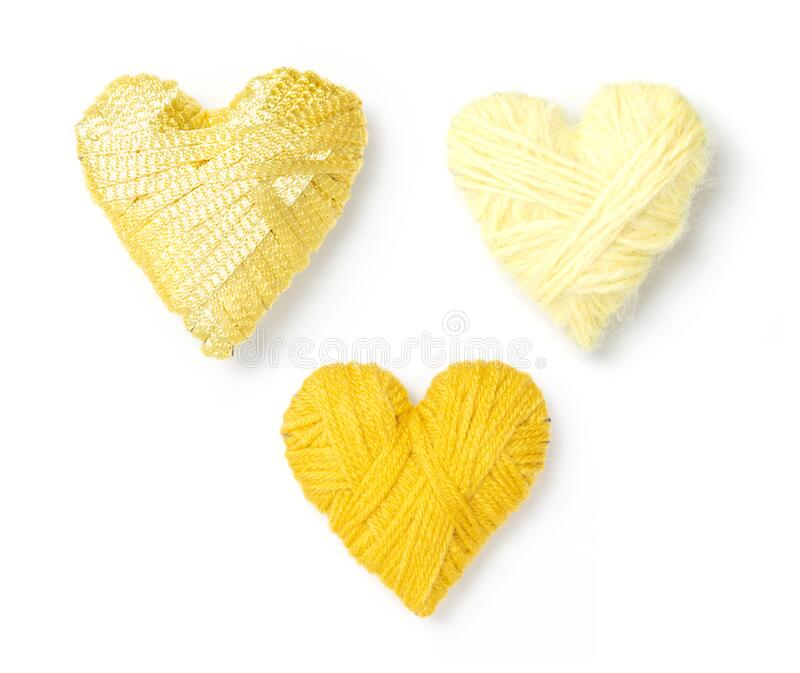 Three yellow wool hearts stock images
