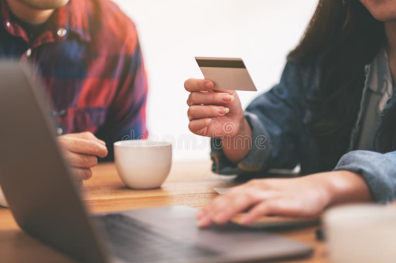 Asian people use credit card to purchasing and shopping online. Three young asian people use credit card to purchasing and shopping online royalty free stock photos