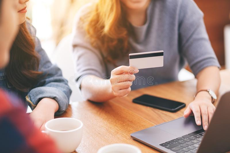 Asian people use credit card to purchasing and shopping online. Three young asian people use credit card to purchasing and shopping online stock photos
