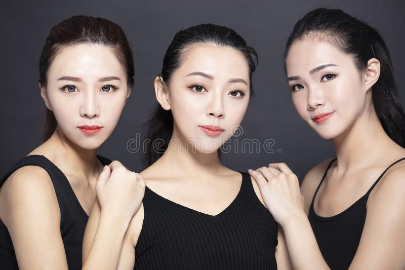 Three young beauty with black background stock photo