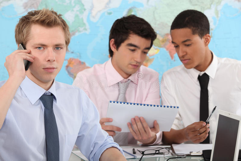 Three young businessmen. Eager to succeed royalty free stock images