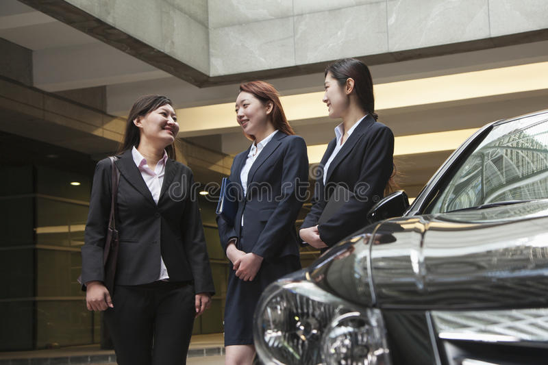 Download Three Young Businesswomen Meeting And Talking In Parking Garage Stock Images - Image: 31694804