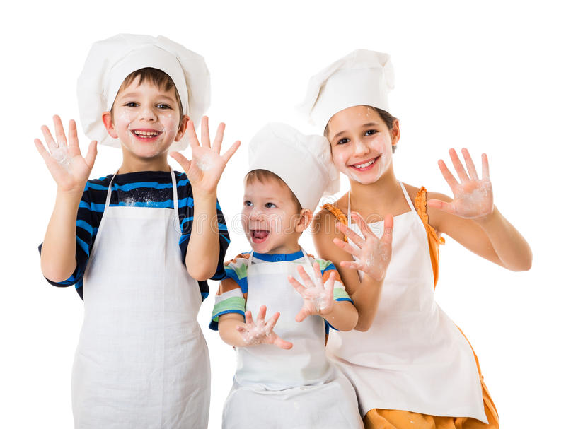 Three young chefs with hands in flour. Three young chefs with raised hands in flour, isolated on white royalty free stock photos