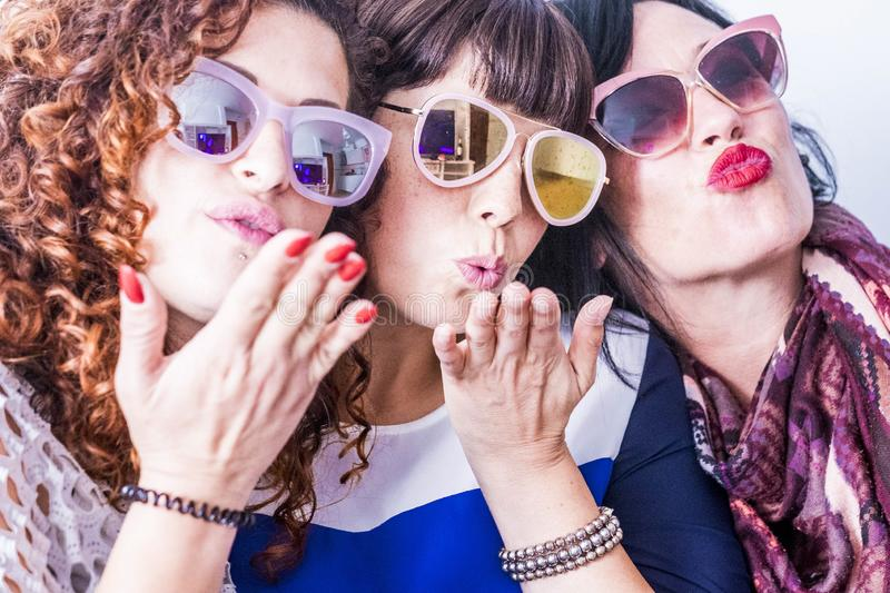 Three young crazy funny women royalty free stock photography